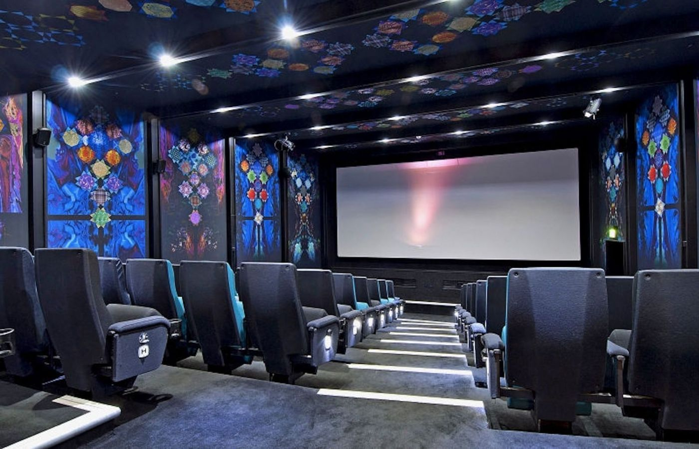 A cinema room with blue patterned walls