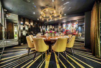 black and yellow themed dining room