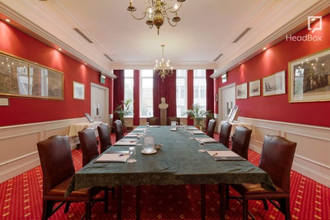 A small conference room with red walls