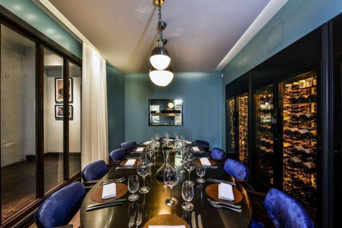 wine bottles stocked floor to ceiling