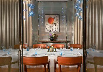 orange themed dining room bulgari hotel