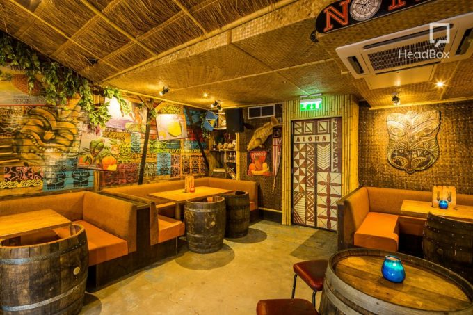 ]tiki inspired restaurant with bamboo ceiling