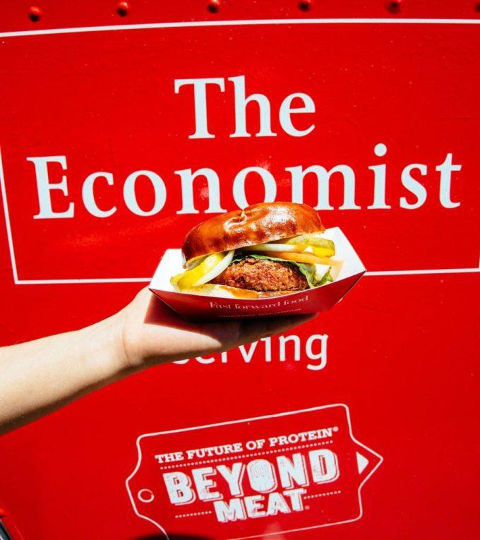 burger held in front 'The Economist'