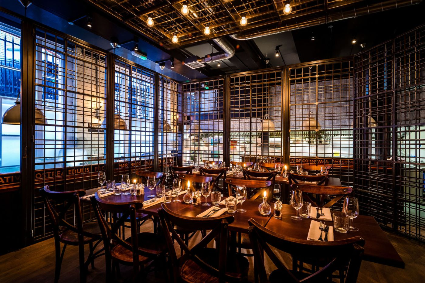 The Cage at The Wright Brothers is a unique provate dining area. The two tables of 8 are in the middle a human-sized lobster cage.