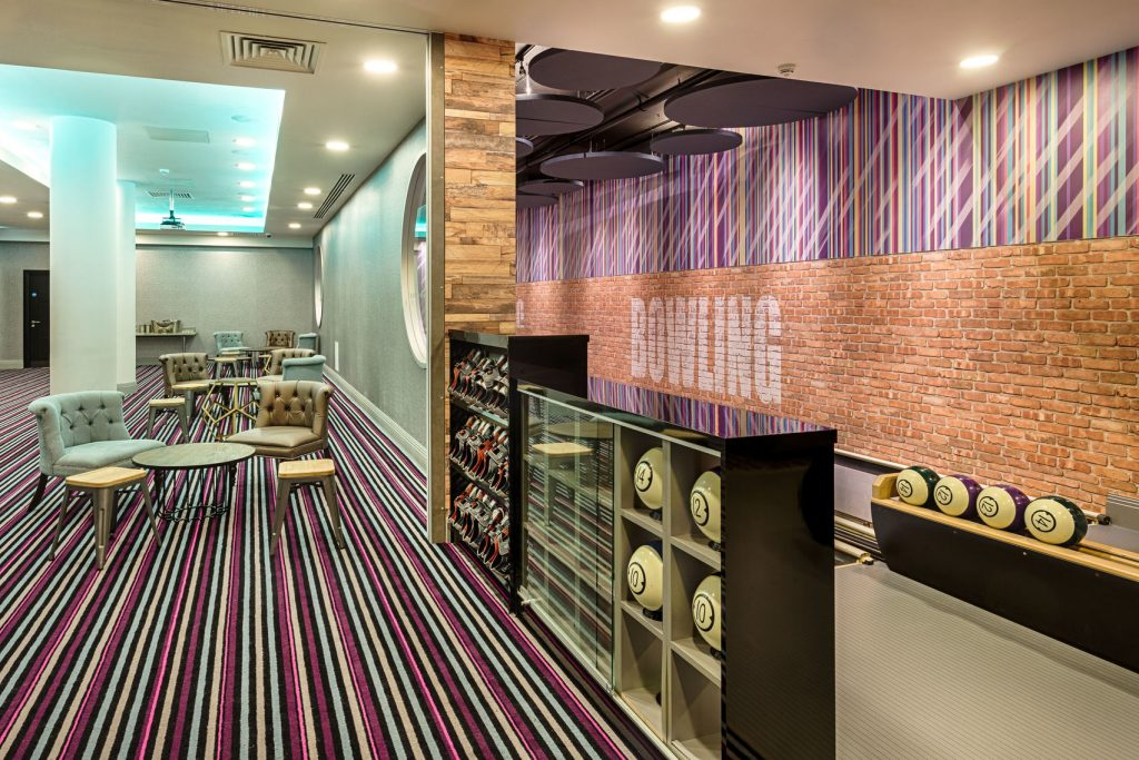 london hotel room half lounge, half bowling alley