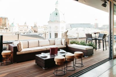 terrace overlooking London with white sofas