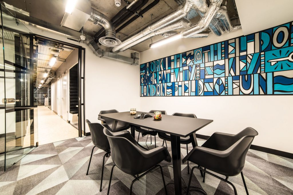 meeting room with colourful blue mural