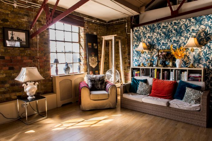 the gallery at lumiere london is a cool loft style event space with sofas and larry wallpapaer