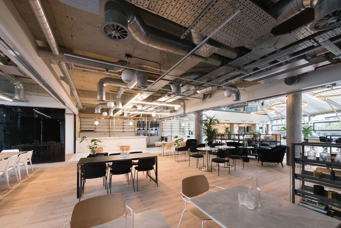 Large event space in London with a range of seating and exposed silver piping