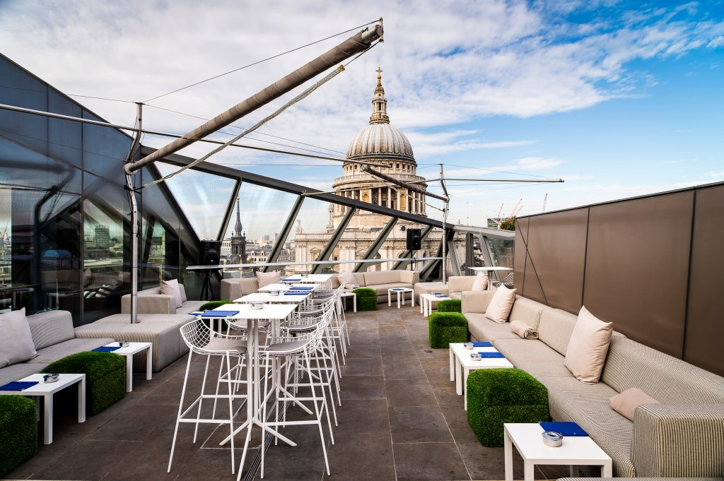 A rooftop with a view of St.Paul's in the background