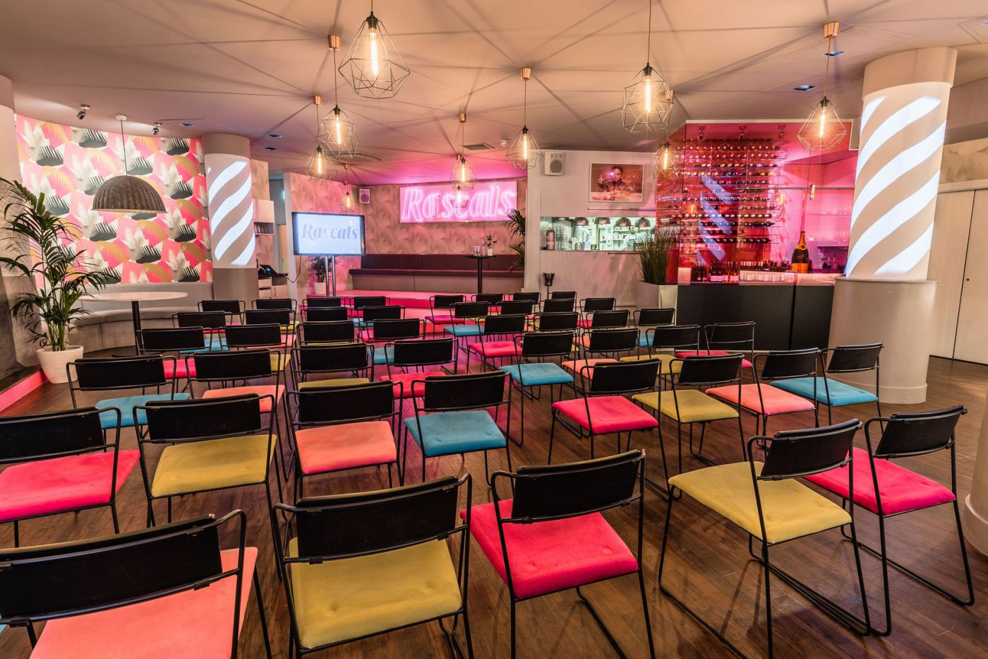 A quirky venue with coloured seats and neon lights