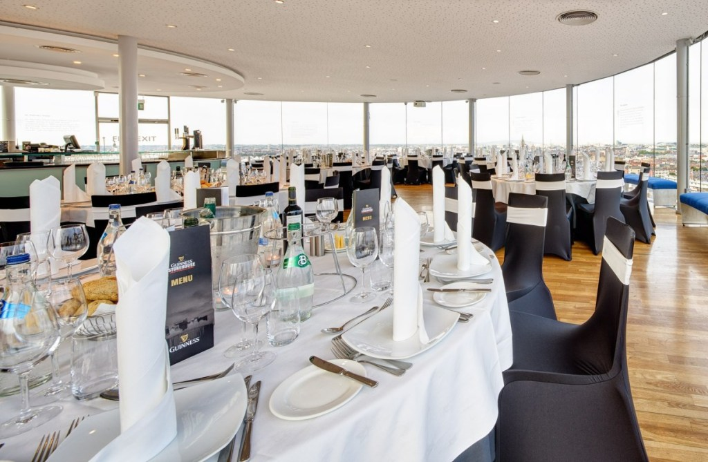 Penthouse party venue with round tables set out with views overlooking Dublin