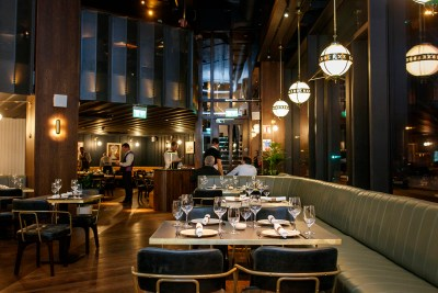 Bar and restaurant with modern light fixtures and dim lighting