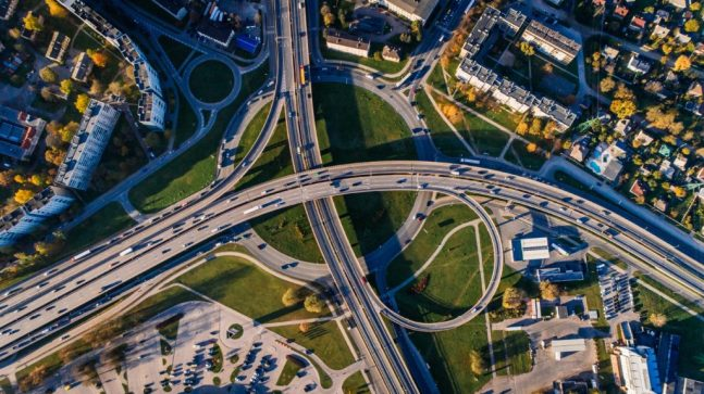 A birds eye view of cars driving on a road