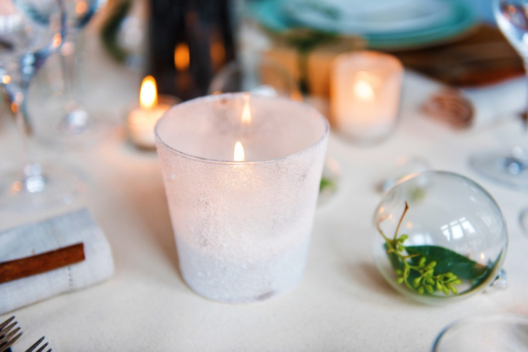 holiday table setting with candles and decorations