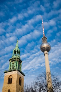 Bell tower of a church and the tv tower of Berlin