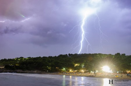 Lightning hitting the forrest close to the sea, Italy