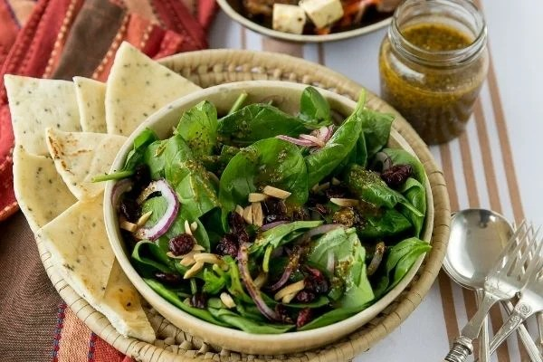 Festive Baby Spinach and Cranberry Salad Jewel-like colours with this Festive Baby Spinach and Cranberry Salad in this salad, together with the crunch of almonds and crisp baby spinach, all combine very well