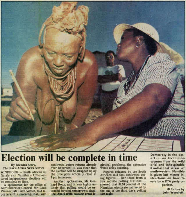 An Ovanimba woman from the wild arid and inhospitable Kaokoland area is given instructions on how to vote. Picture by John Woodroff.
