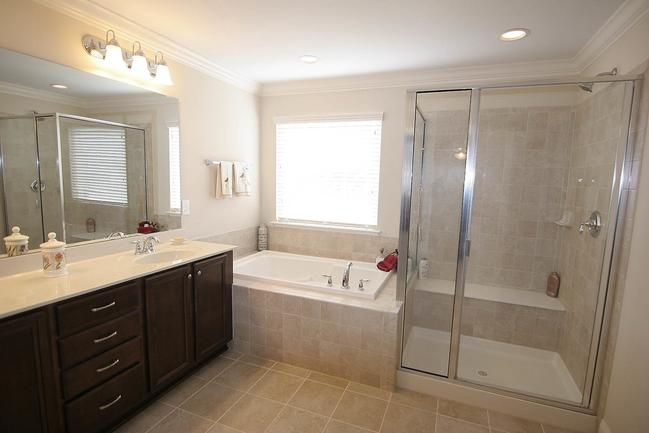 Spacious master-bathroom with large tub.