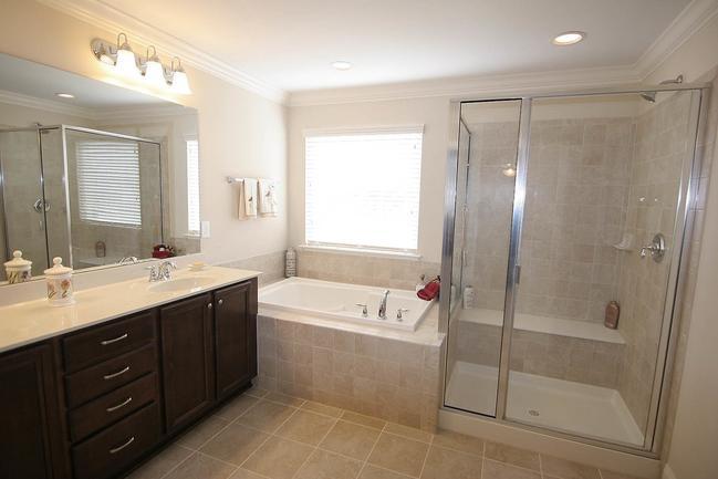 Spacious master-bathroom with large tub.