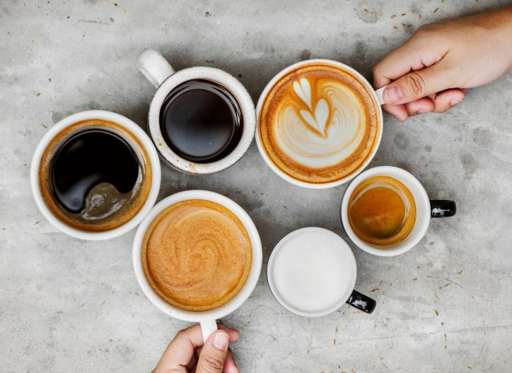 Multiple mugs of coffee, cappucinos, and lattes.