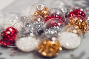 Ornaments filled with silver, gold, and red sparkles.