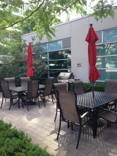 Many condominium developments offer lovely shared amenities such as outdoor barbecue and dining areas.