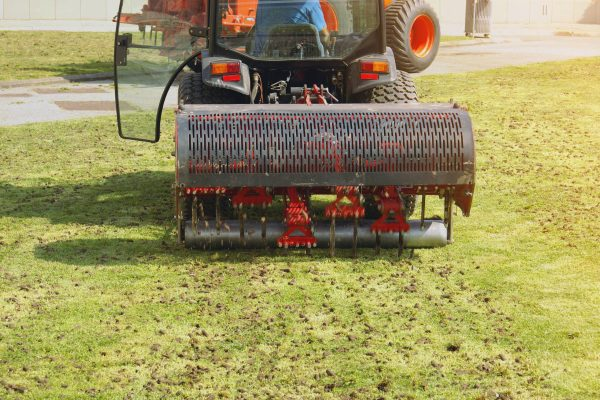 aerate lawn with special machine