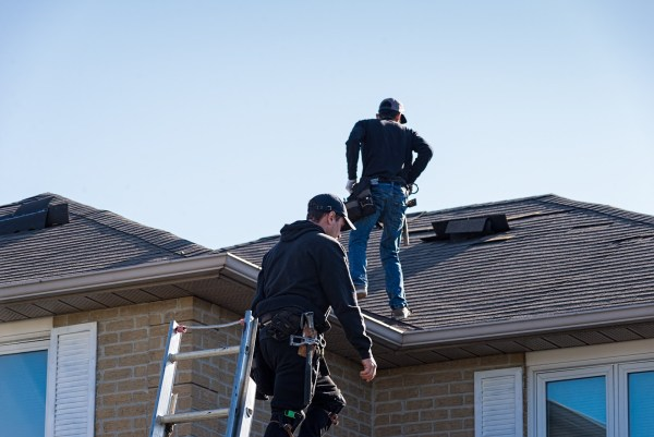 roofers on roof