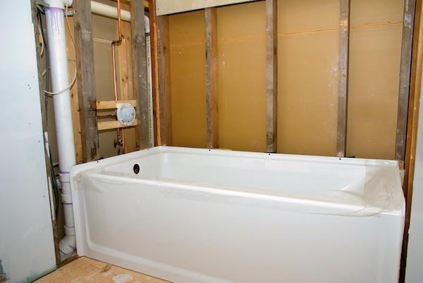 framing around bathtub during bathroom renovation