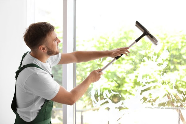 window cleaner cleaning window interior