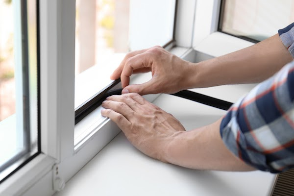 adding weather stripping to window