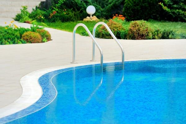 swimming pool in summer backyard