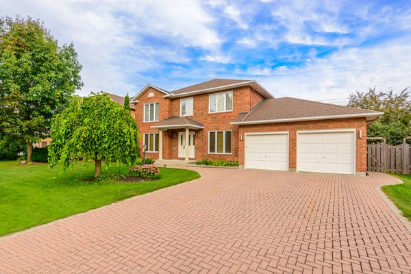 front yard of house with interlocking stone driveway