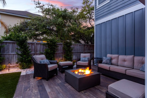 outdoor furniture surrounding firepit