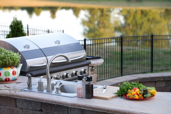 outdoor kitchen with sink counter and bbq