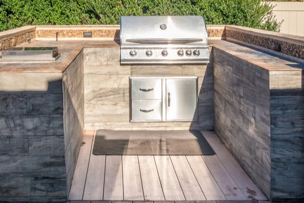 outdoor kitchen construction of counter top islands with cabinets and bbq