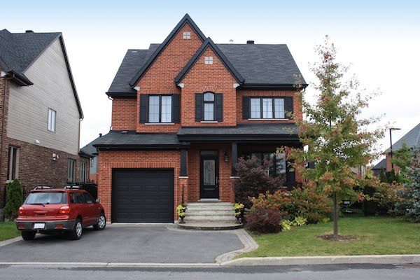 Canadian home with asphalt driveway