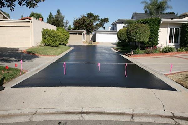 freshly paved asphalt driveway