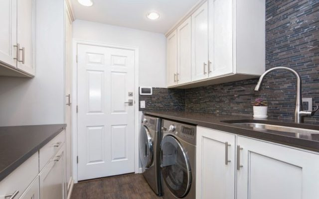 laundry room with counter space and cabinets