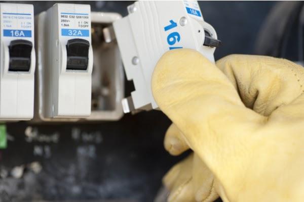 hand holding circuit breaker