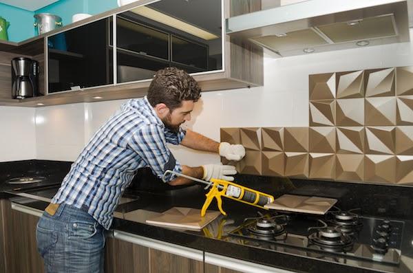 pro installing backsplash in kitchen