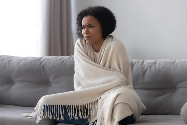 woman cold on couch