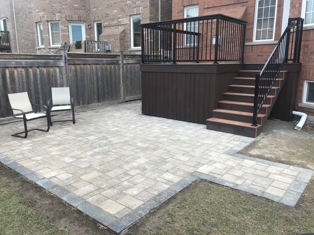 backyard with stone patio and new deck