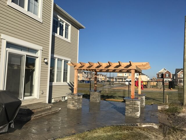 backyard pergola and interlocking patio