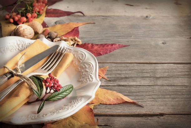 44237567 - autumn rustic table setting with berries, leaves, acorns and nuts