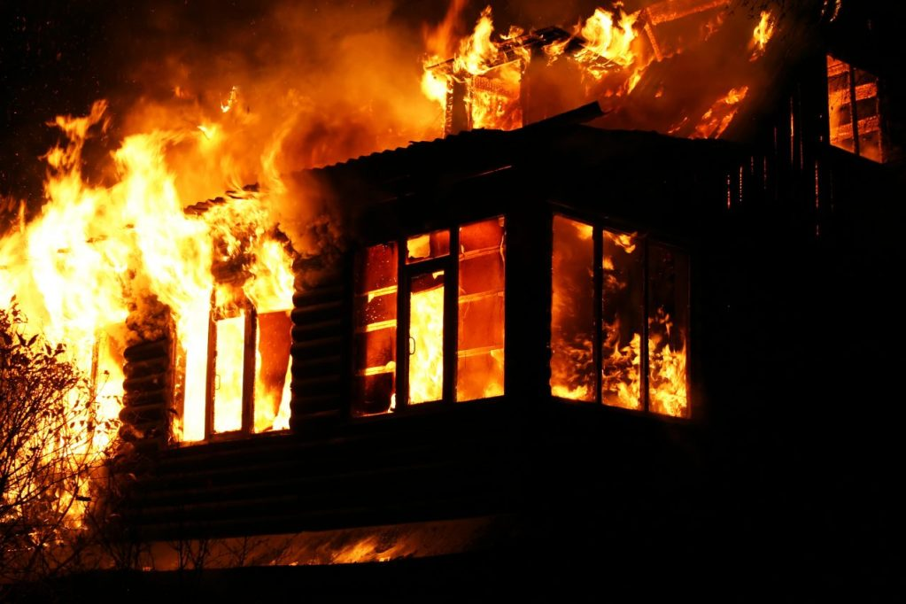house burning down with vigorous fire
