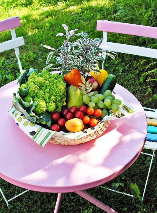 A basket of homegrown fruit and vegetables. d