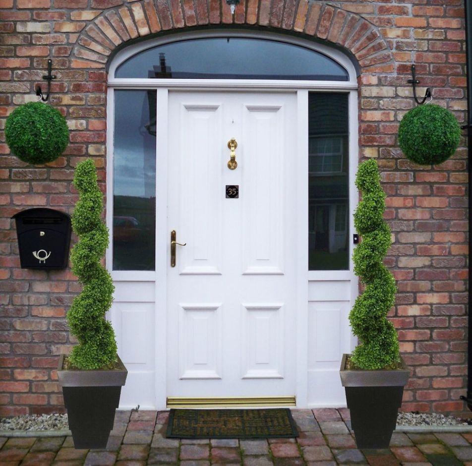 Front door with Buxus spirals